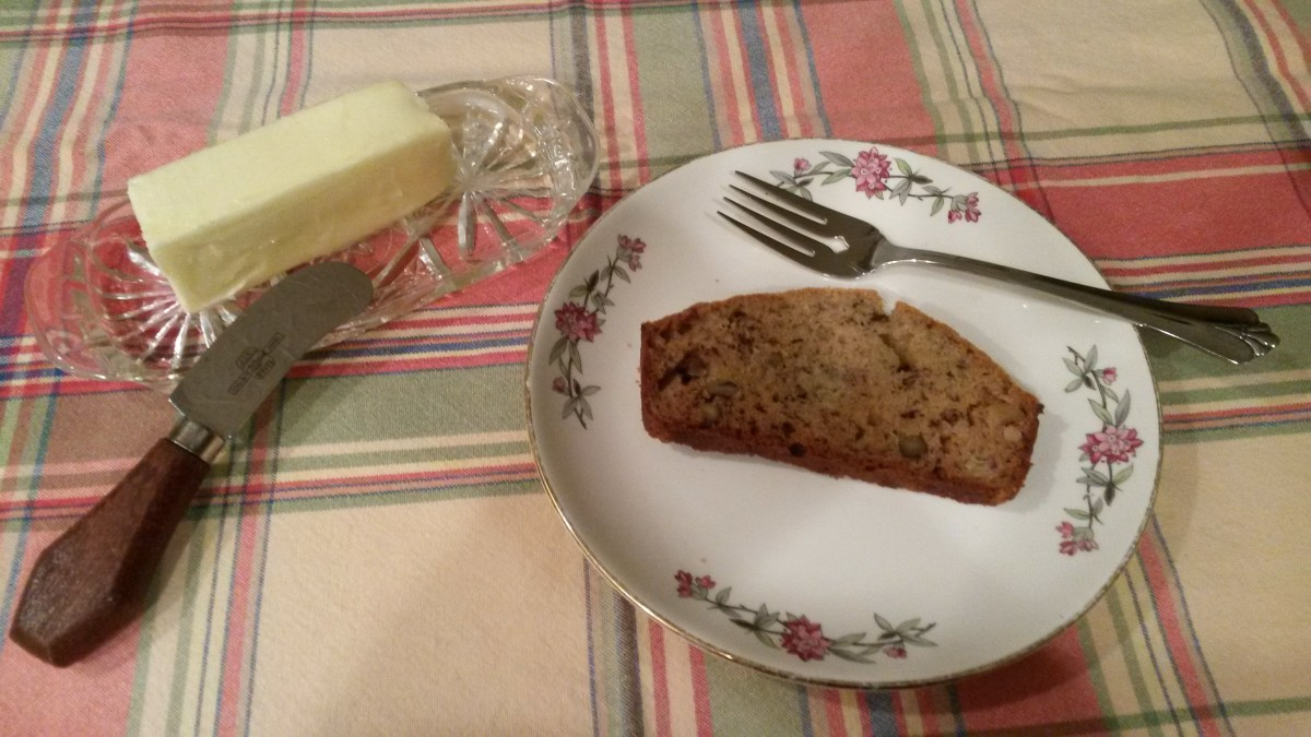 Banana walnut bread served warm with butter.