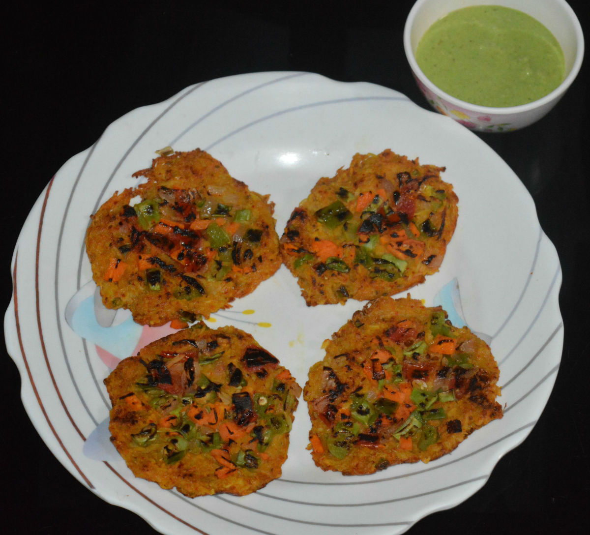 Spicy Potato Pancakes served with green chutney/sauce