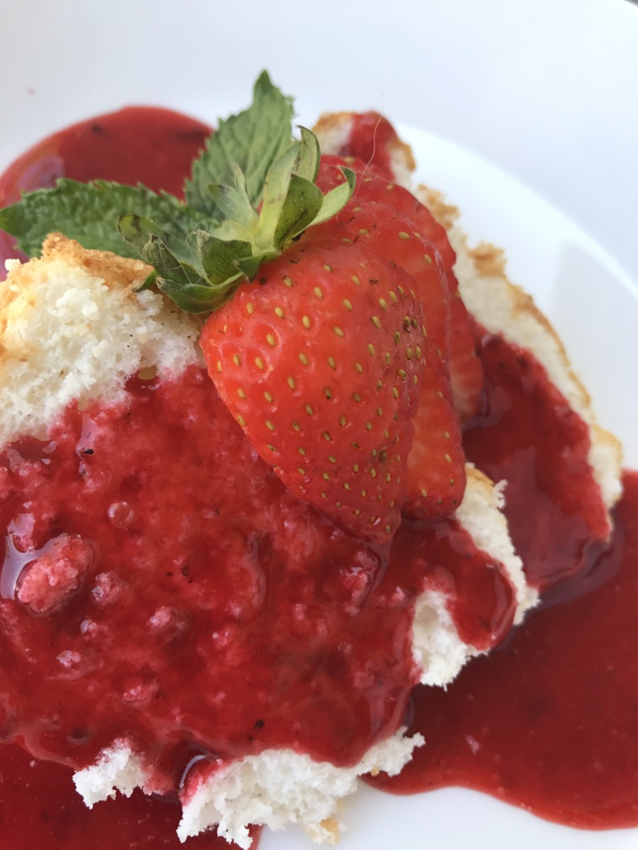 Served on its own or with a simple dessert sauce like this strawberry, homemade angel food cake is a glorious winner!