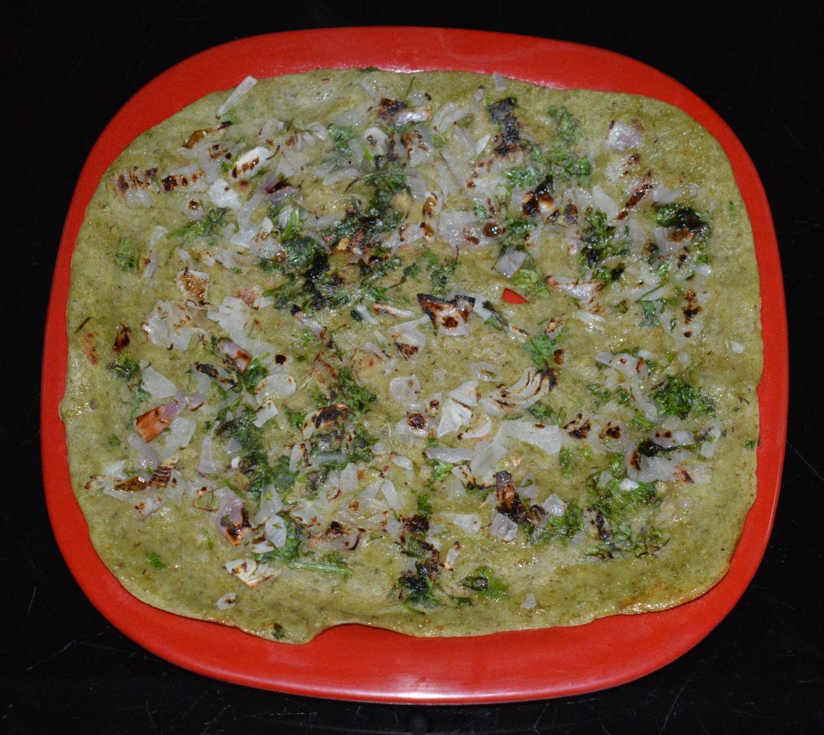 A mung bean pancake (pesarattu).