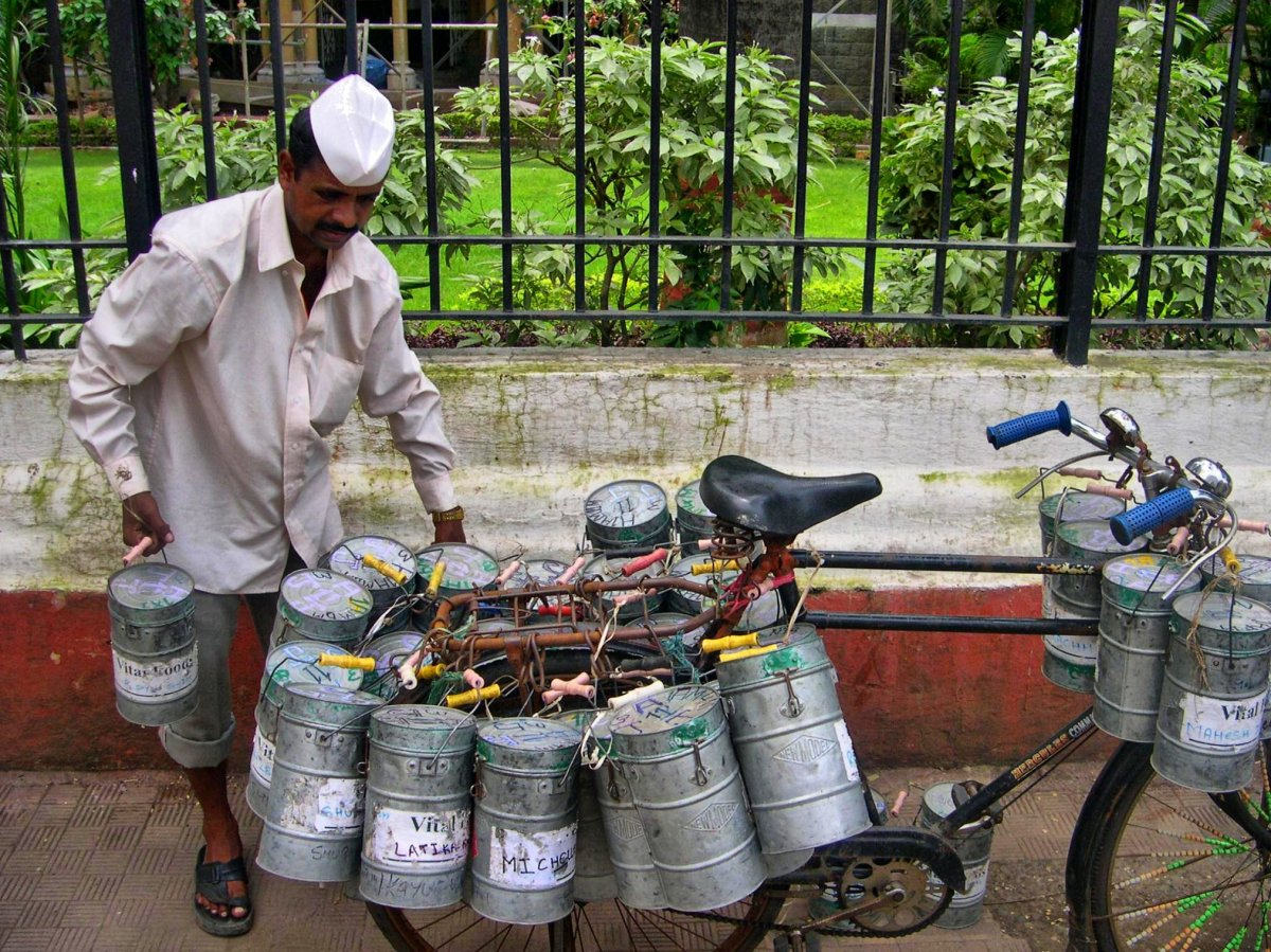 A dabba wallah loads his bicycle.