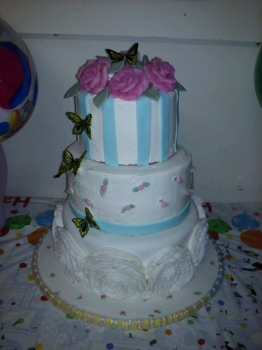 All tiers of this cake were previously frozen, thawed, and decorated on the day they were due. It tasted incredible, exactly as good as fresh cake.
