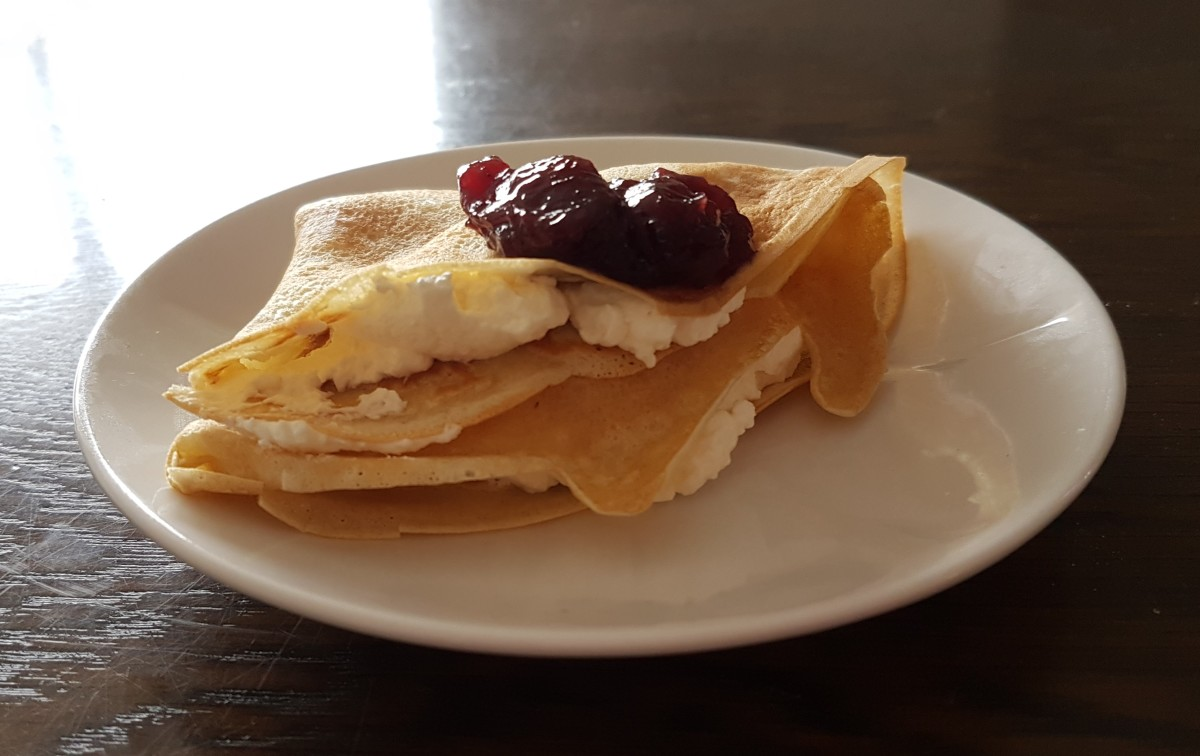 Icelandic pancake with whipped cream and jam.