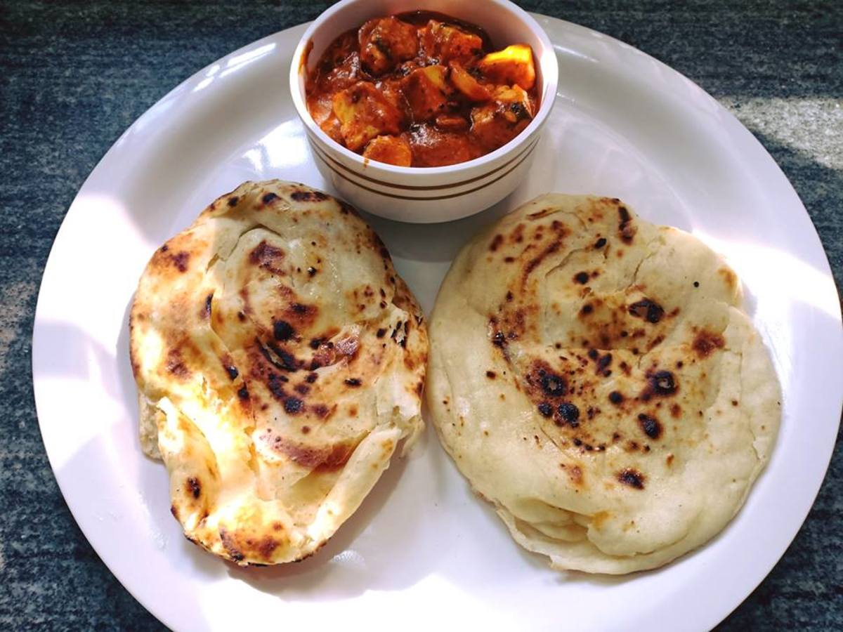 For those without a tandoor, butter naan can also be baked in a tawa (skillet).