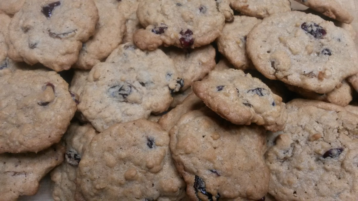 A batch of oatmeal raisin cookies made with cherries and cranberries.