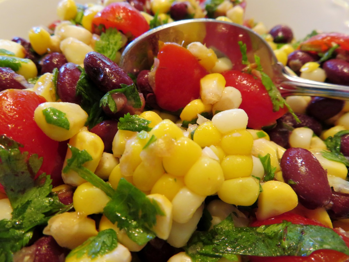 This corn, black bean, and fresh tomato side dish tends to disappear quickly at parties and gatherings.