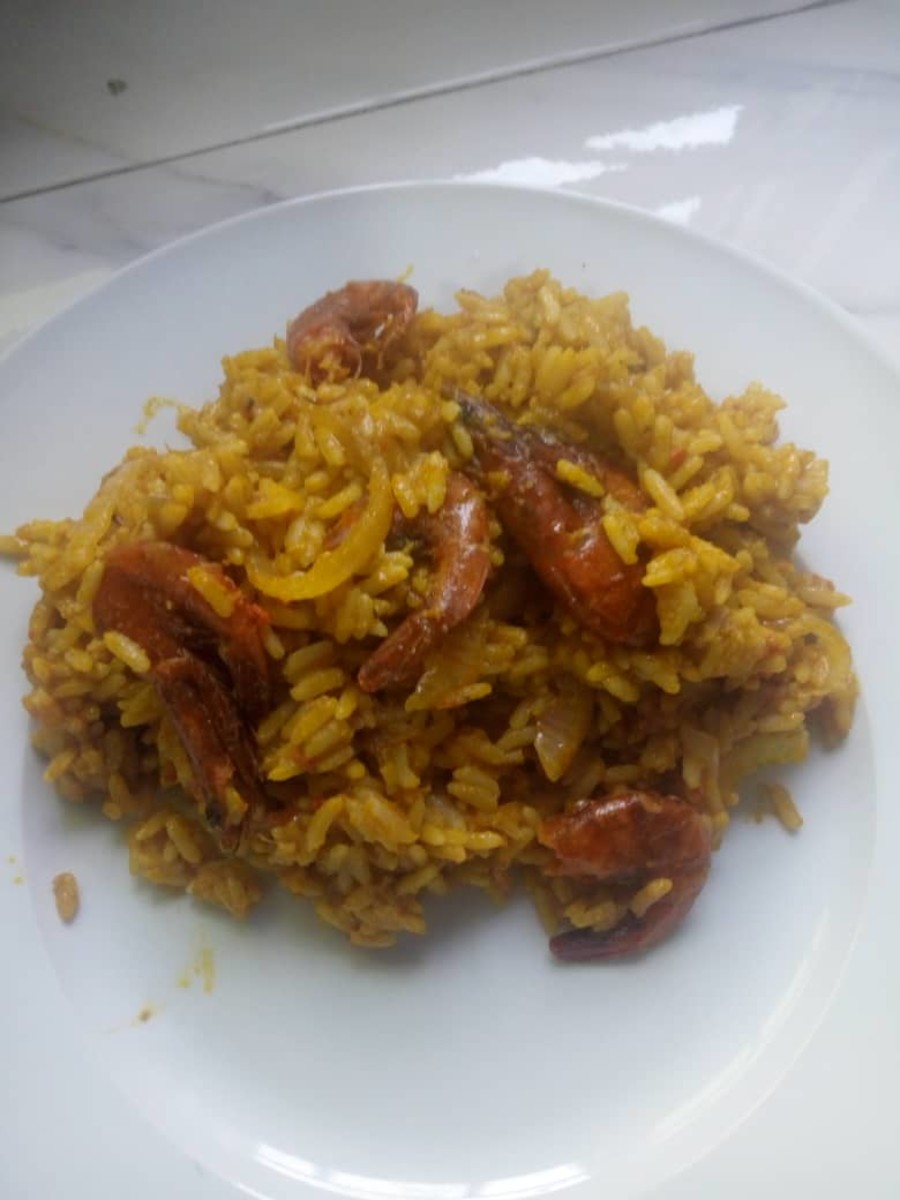 Palm oil rice with dried prawns is a classic dish from Nigeria.