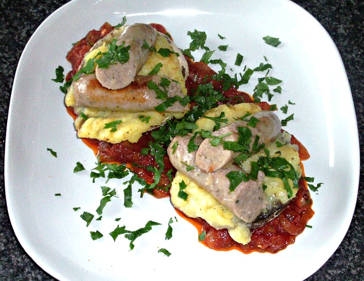 Mashed potato stuffed portobello mushrooms with sausages and spicy tomato sauce