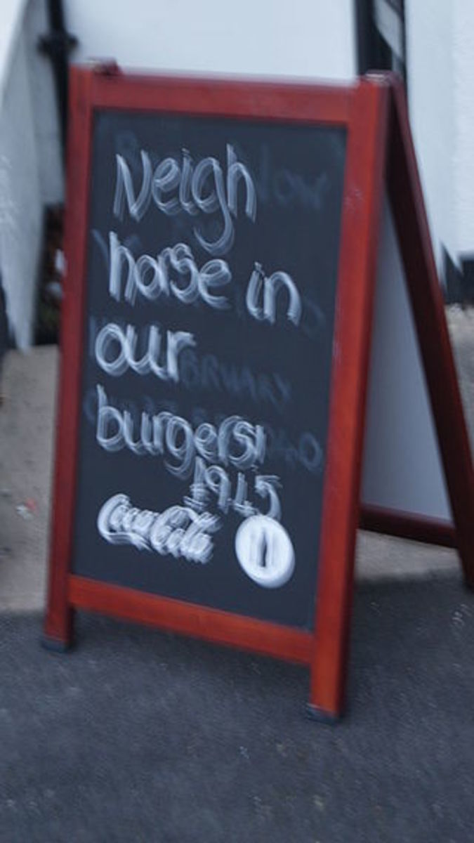 Sign outside a pub in England which may account for the camera shake.