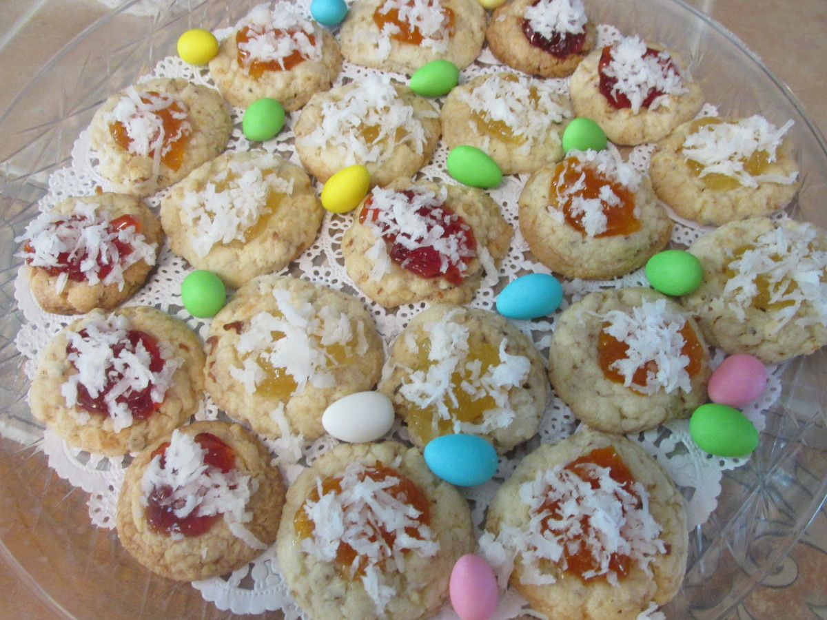 Coconut Thumbprint Cookies with three different toppings.  Strawberry jelly, apricot preserves and pineapple preserves.