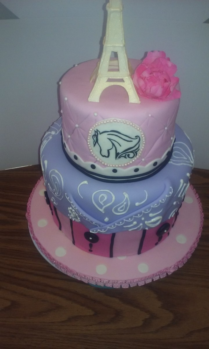 Here is a great example of using several different mediums to achieve my vision. The Paris cowgirl themed cake is covered in different layers of fondant, the bandanna has hand piped royal icing detail on top, the Eiffel Tower and peony were made from