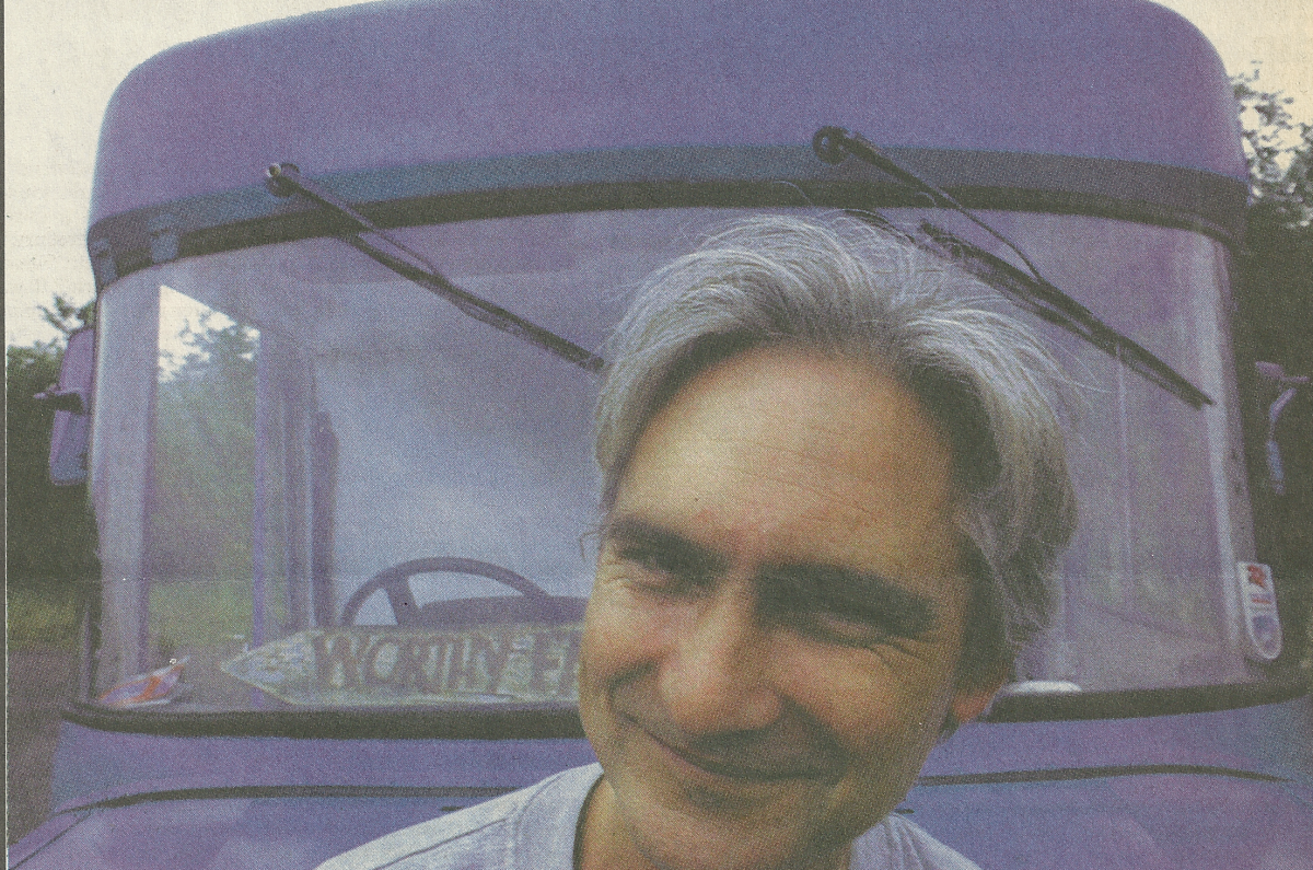 CJ Stone, in front of his van, from The Big Issue