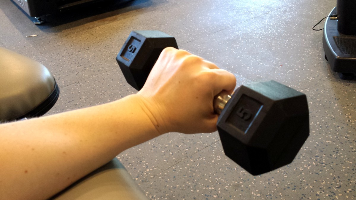 To strengthen the top of the forearm, curl upward with palm down.