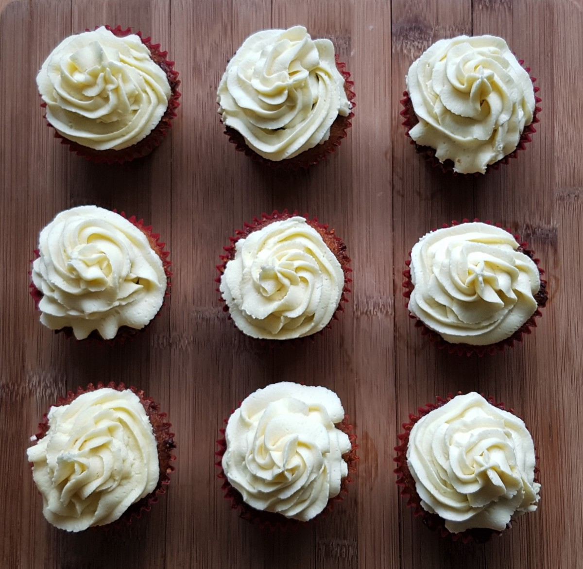 Carrot cake cupcakes with white chocolate buttercream frosting