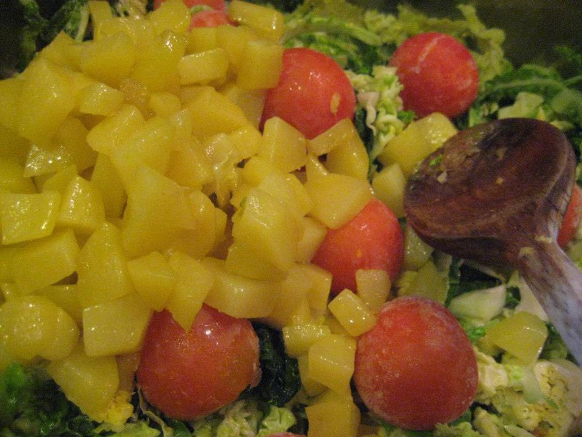 Potatoes with kale and tomatoes
