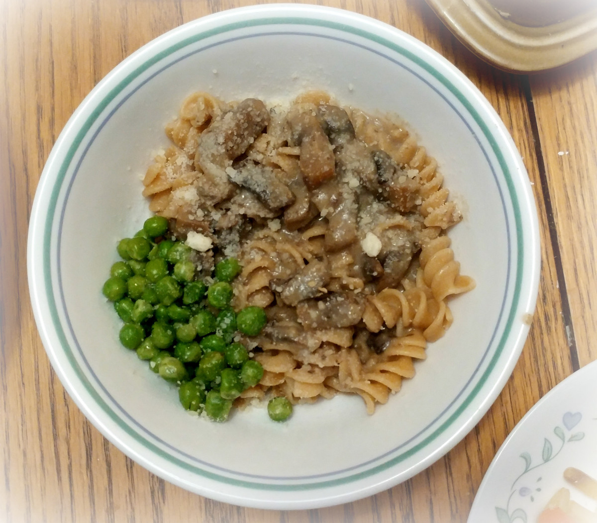 Served over whole wheat noodles with a side of peas!