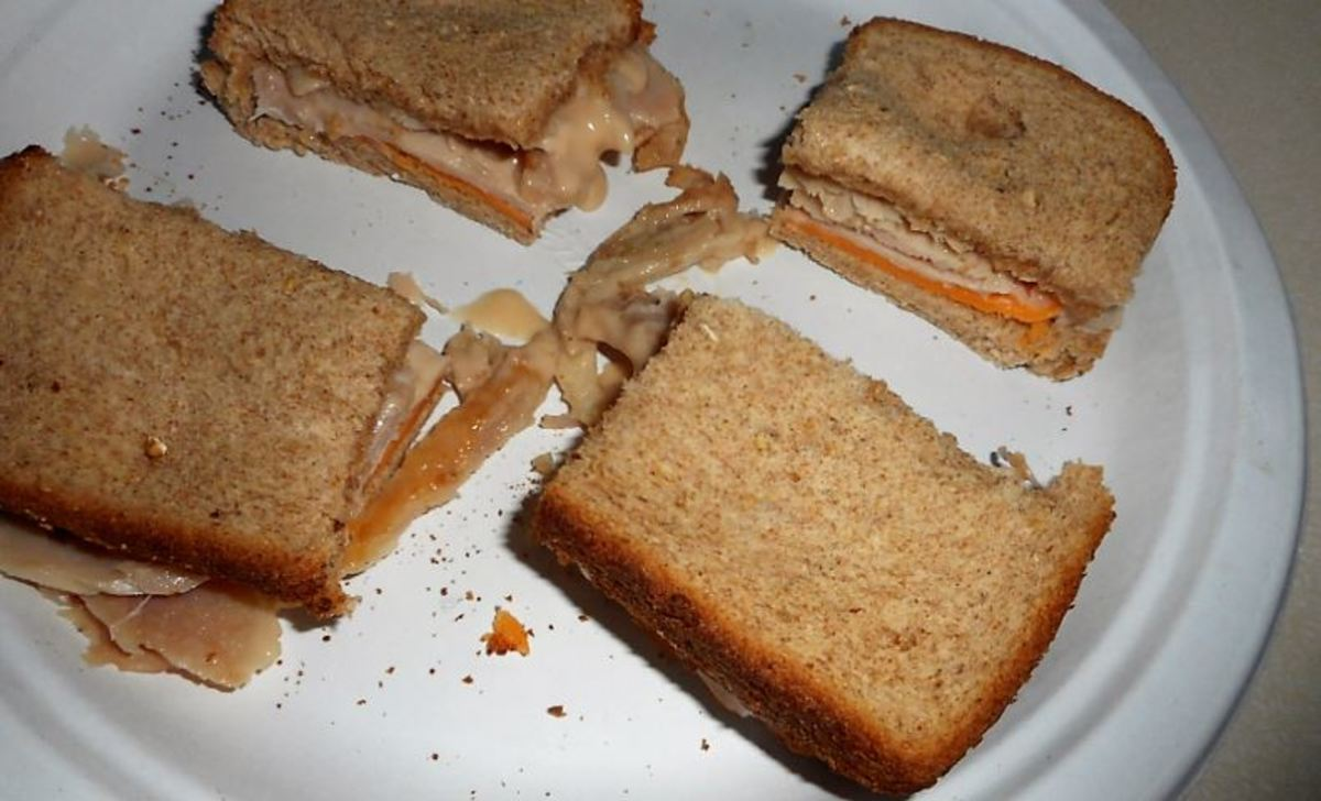 A batch of toaster oven cheese and turkey sandwiches.