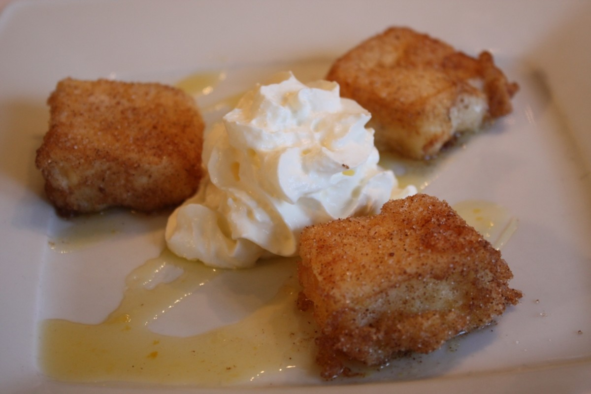 Leche frita with whipped cream.