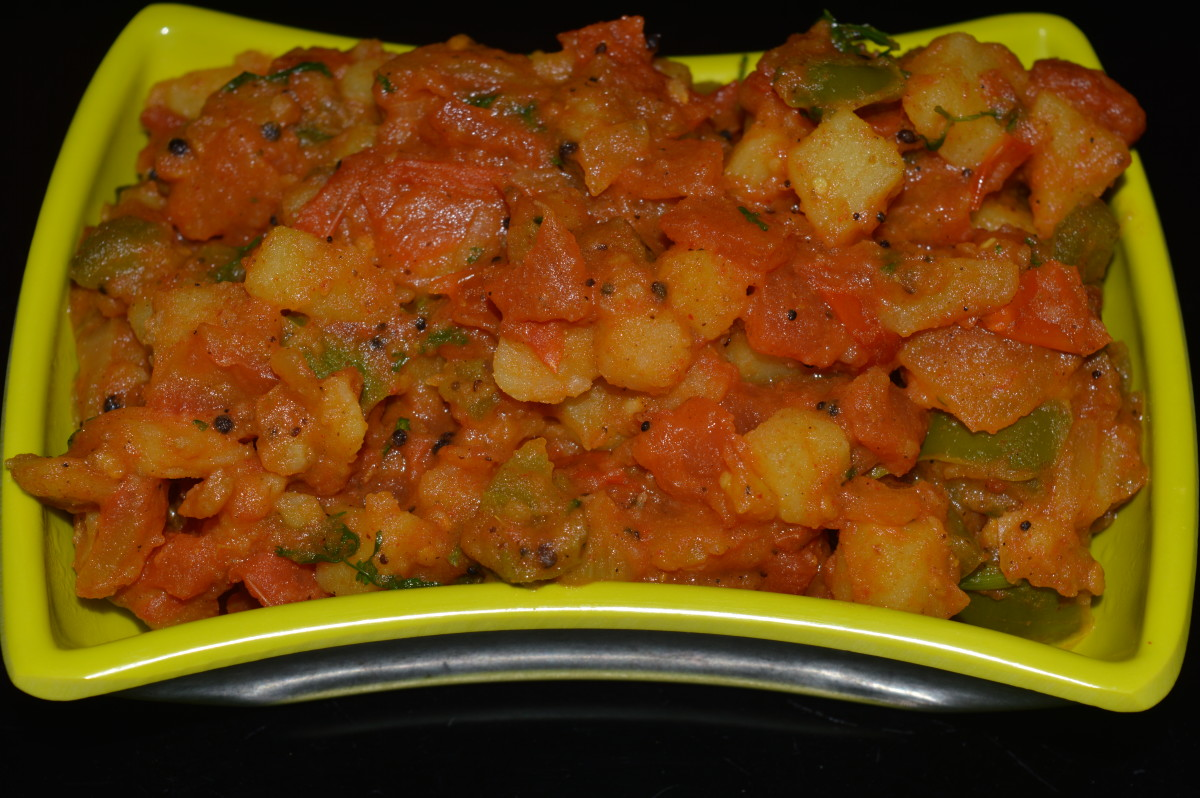 Potato, tomato, and capsicum dry curry.