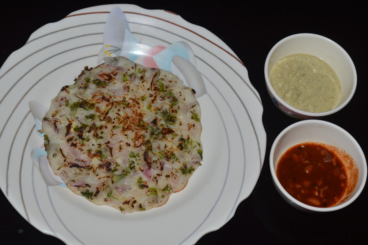 Onion pancake or onion uttappa served with red and green chutney/sauce