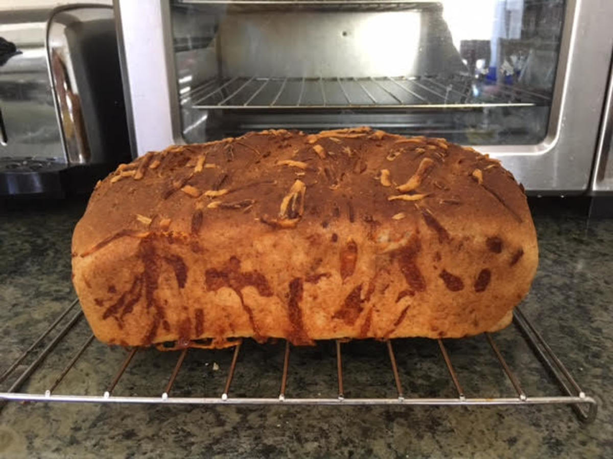 finished loaf of whole wheat cheese bread