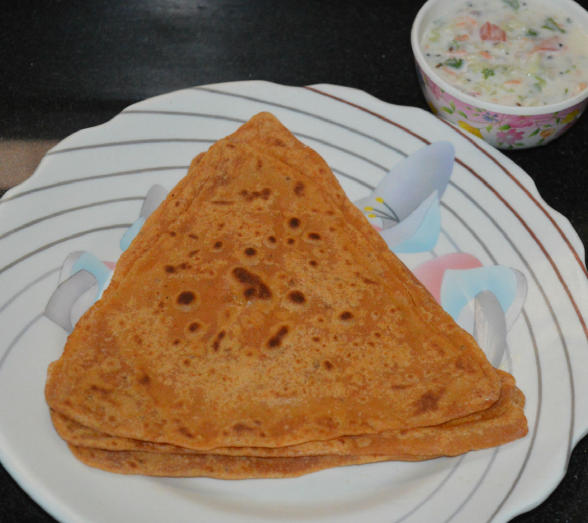 Triangle parathas with vegetable raita