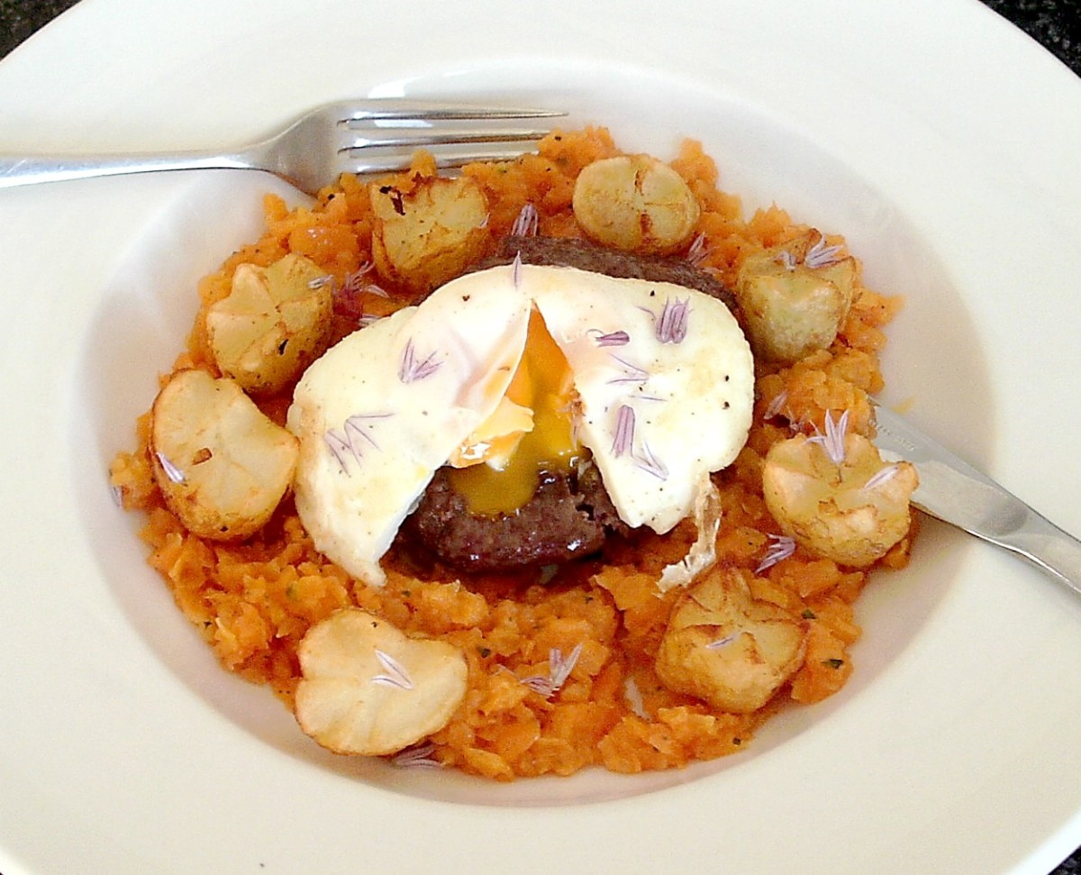 Buffalo and beef burger on mashed carrot bed with potato crowns and poached egg