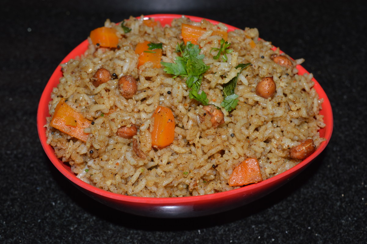 Puliyogare with carrot cubes