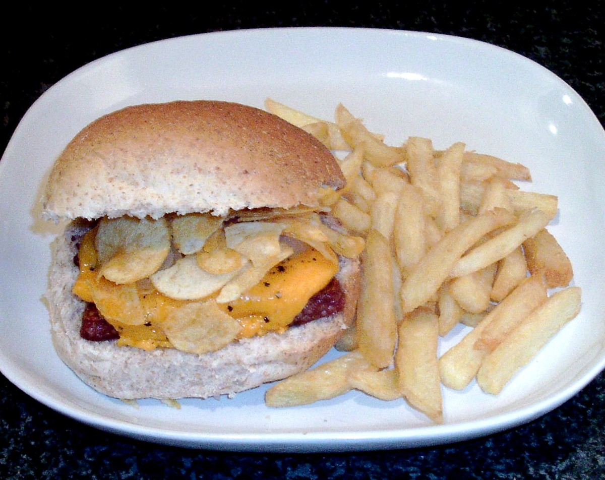 Scottish sliced sausage with Cheddar cheese and cheese and onion crisps sandwich.