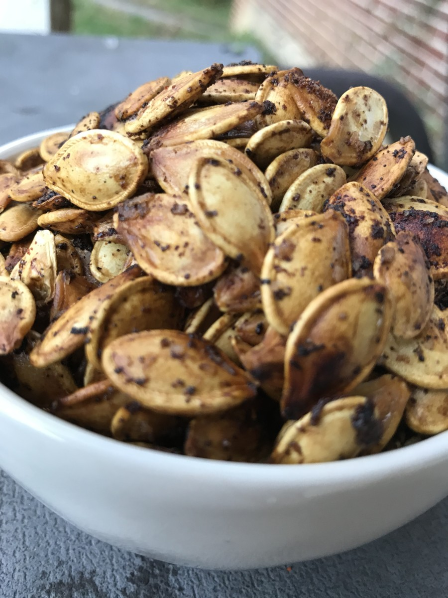 Roasted pumpkin seeds make a super simple, delicious and nutrition packed snack that you actually want your family to eat!  Crunchy, salty and loaded with flavor, this is an ideal fall treat.