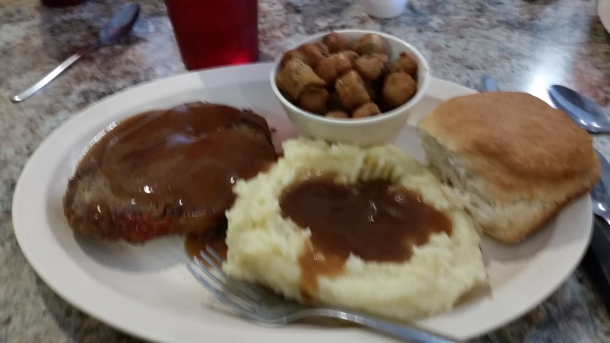 Gravy and more gravy makes the calories add up. Lots of potatoes, a good-sized biscuit, deep-fried vegetables (okra), and a soda, is a good way to pack on the pounds.