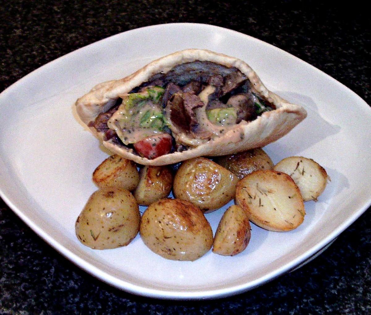 Spicy Lamb Salad Pita Pocket With Garlic and Herb Roasties