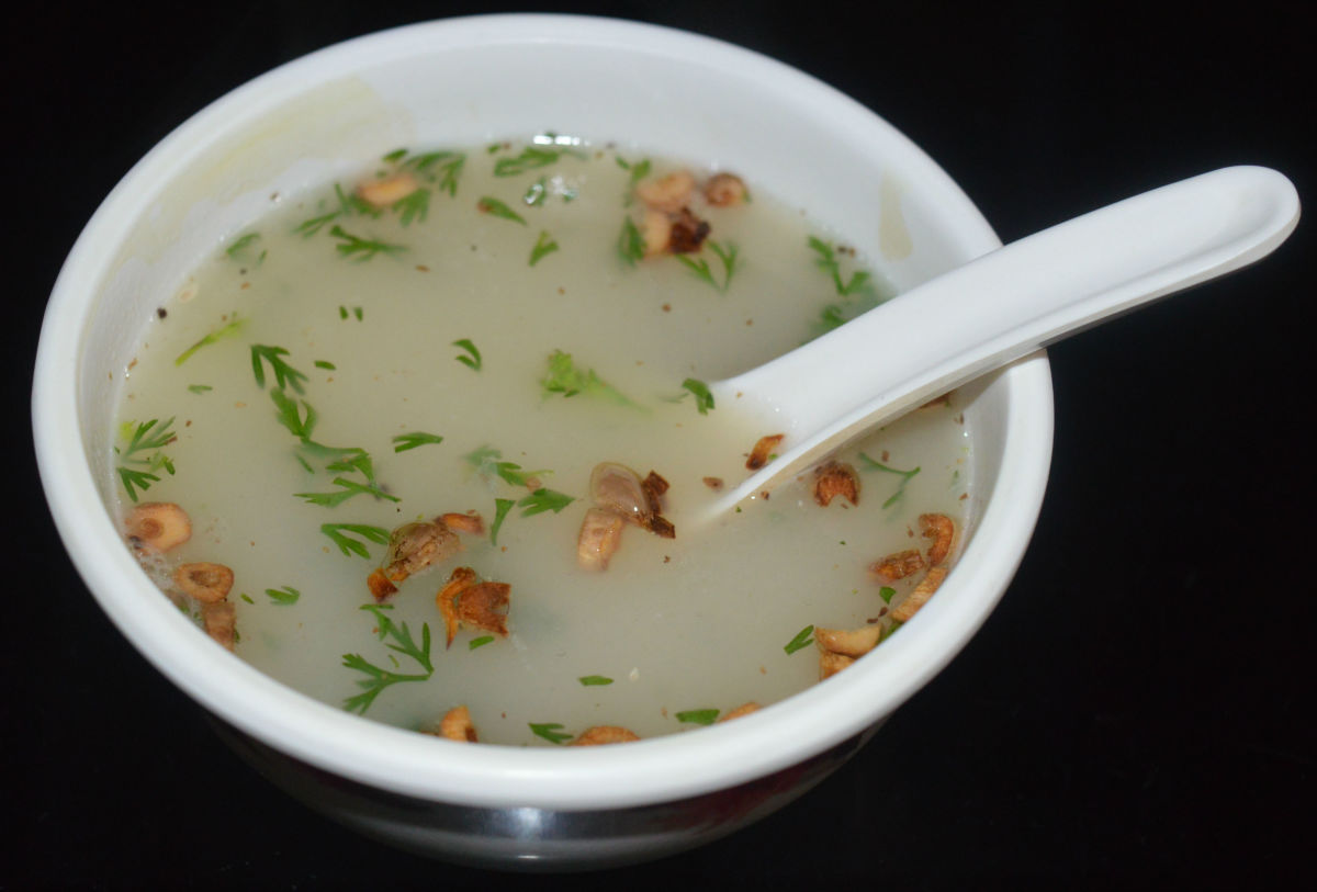 Lemon rice soup with fried garlic.