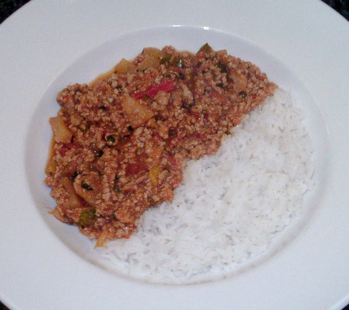 Sweet and spicy pork, peppers and pineapple is served with boiled rice