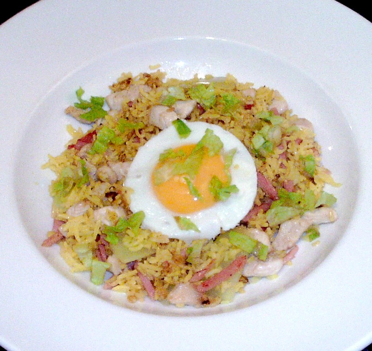 Celtuce, chicken and ham turmeric fried rice with fried egg