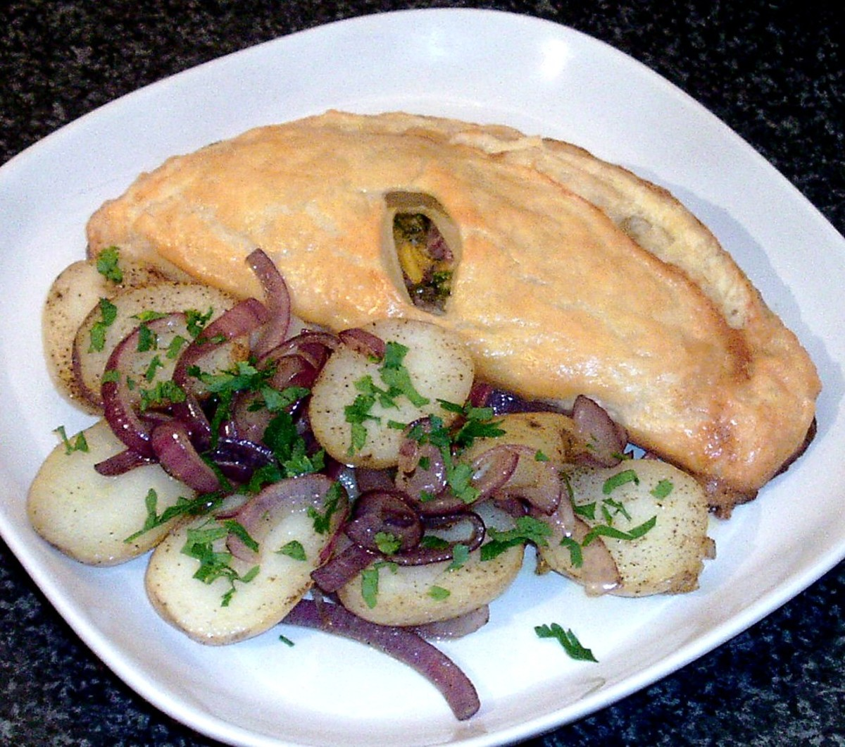 Sea bass and mango salsa en croute with sauteed potatoes and red onion