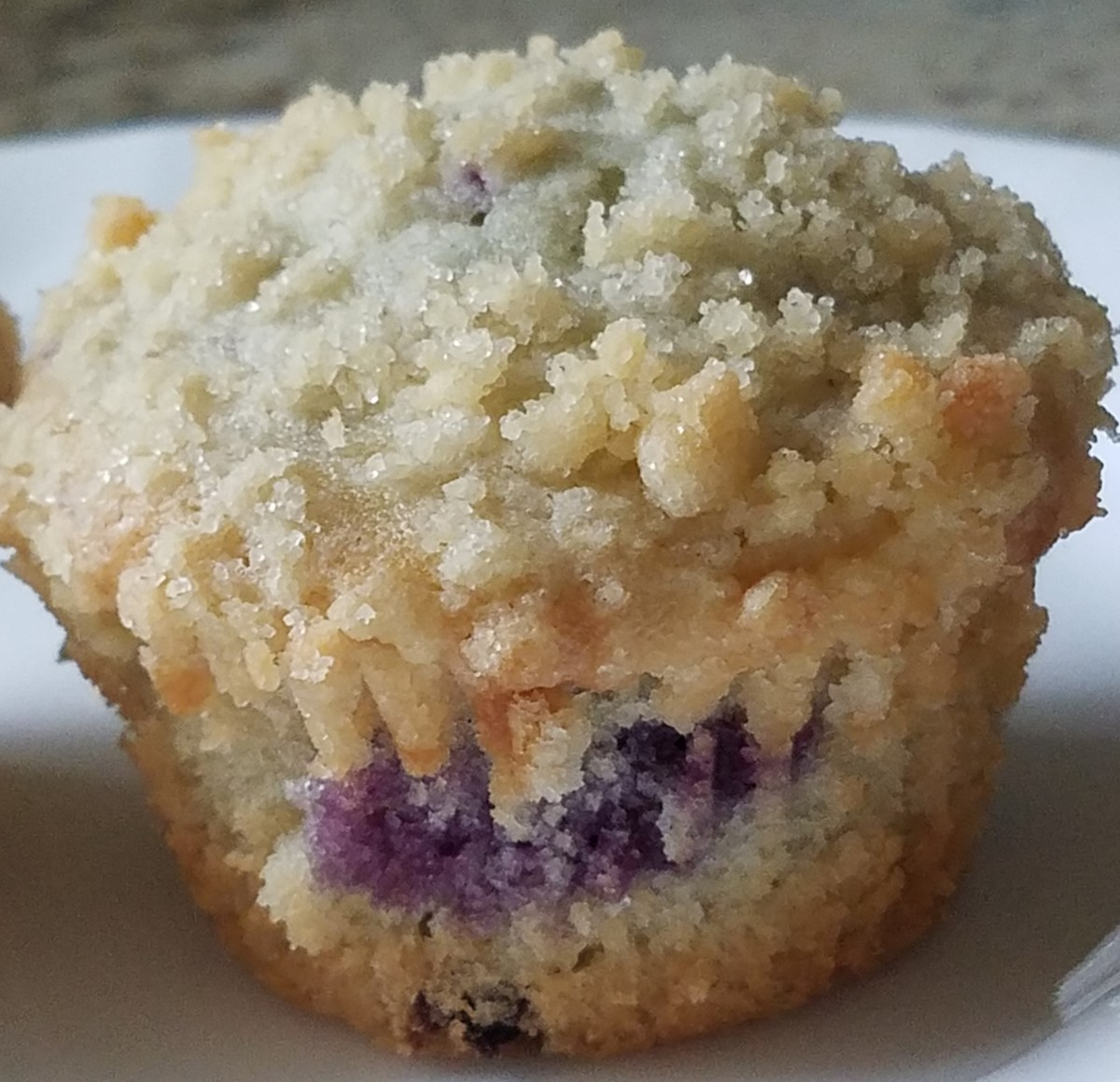 The finished blueberry crumb muffin.