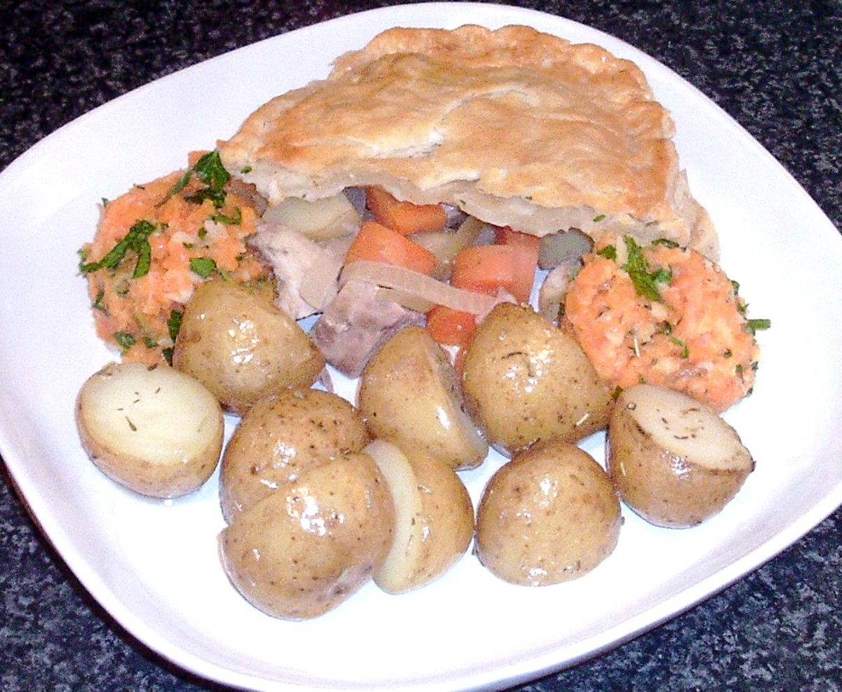Pheasant breast wild game pie with herb roast potatoes and carrot and parsnip mash