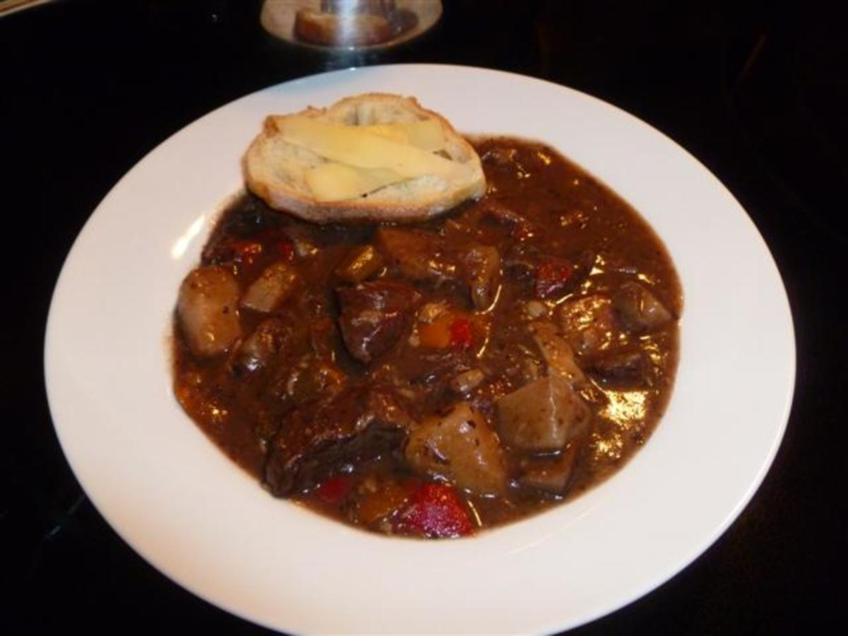 Wonderful bowl of savory beef stew served with toasted crostini garnished with shaved Parmesan.