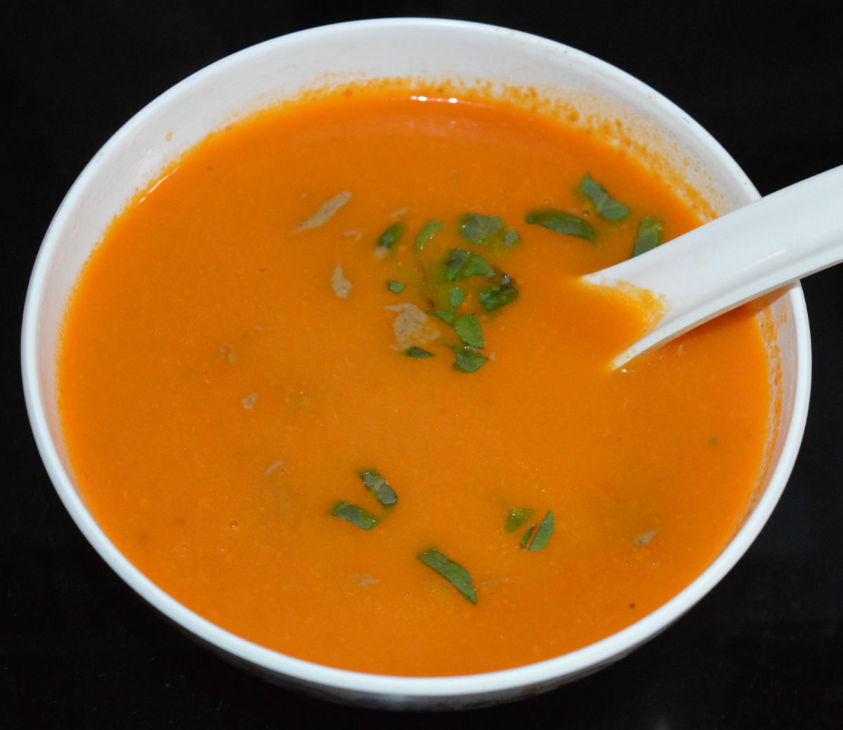 Tomato soup with tahini and basil.
