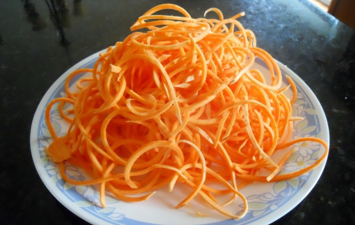 Swoodles - Sweet Potato Noodles - A peeled sweet potato is placed in the spiralizer.  I find it easier to cut the potato in half so there is a flat side. The 1/8 inch (3 mm)  blade was used.