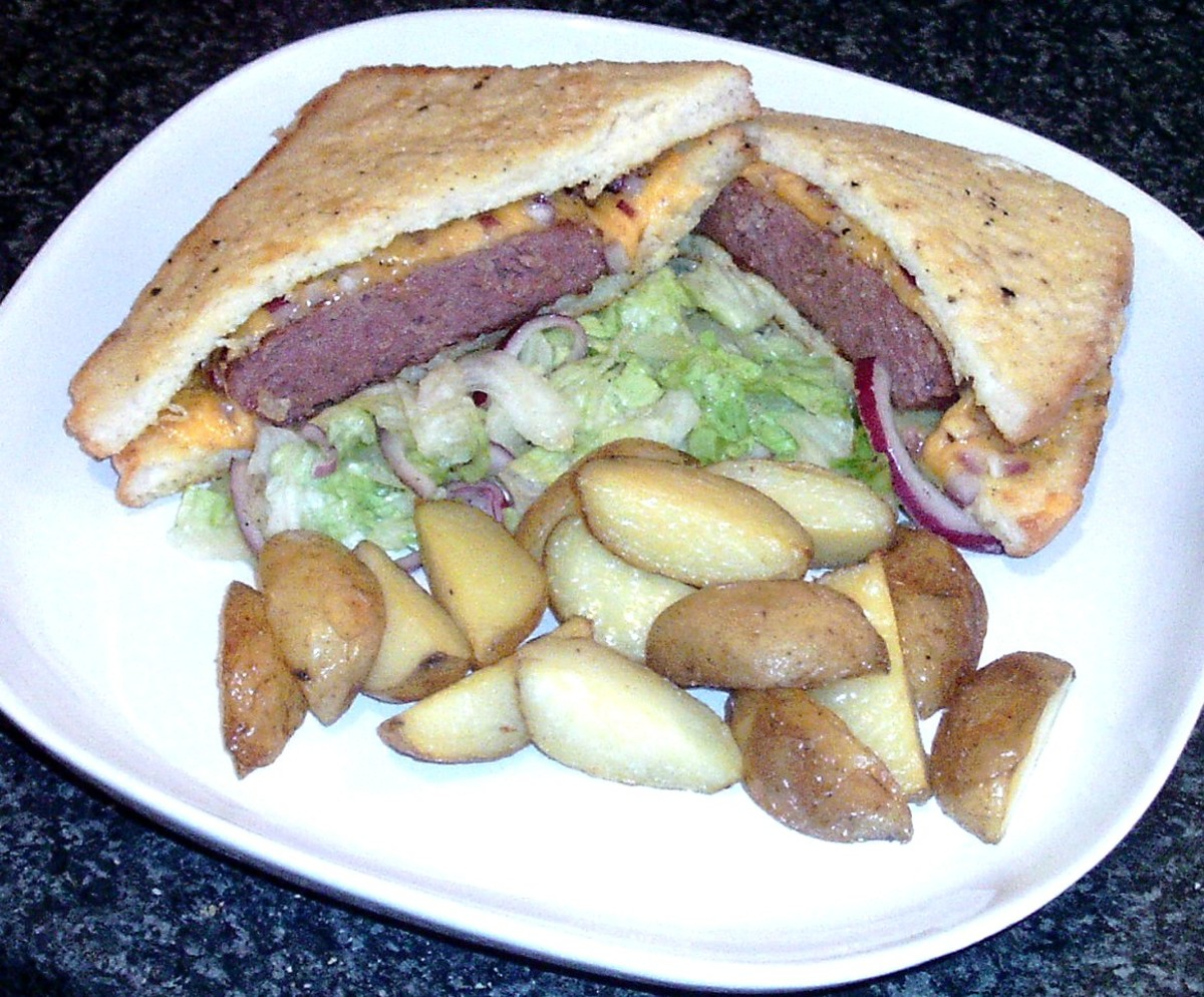 Cheese and onion Belgian blue beef burger eggy bread sandwich with roast potatoes