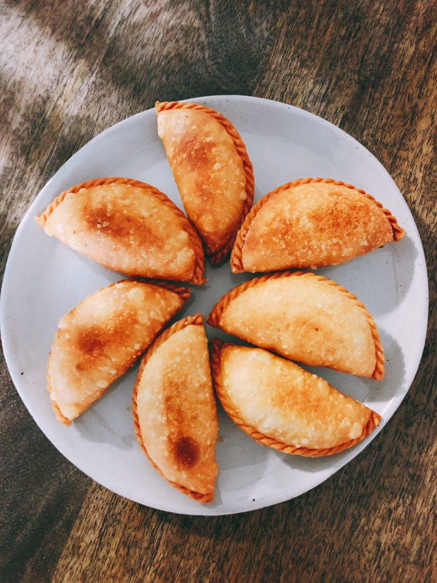 Place the curry puffs on a plate and serve immediately with your favorite drink. Enjoy!