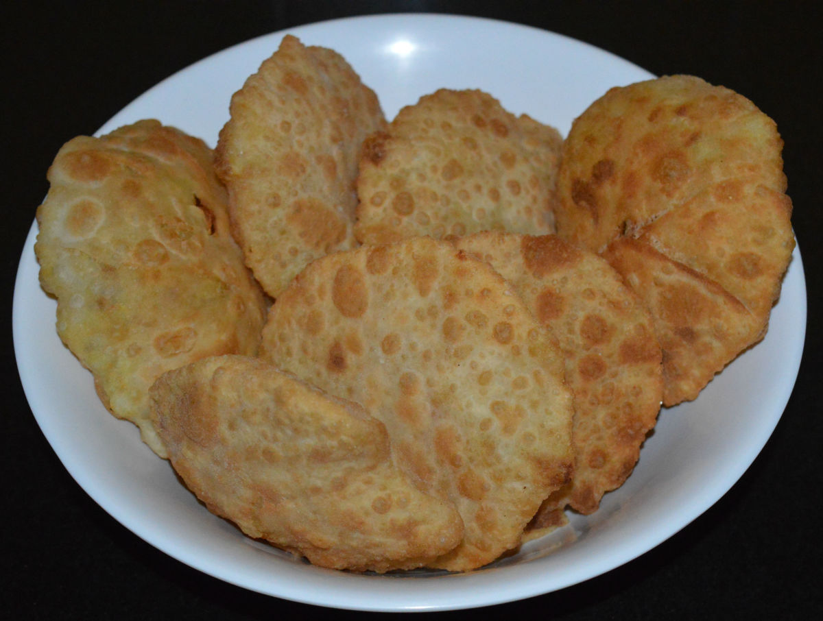 Potato-stuffed pooris make for a great snack or lunchbox addition.