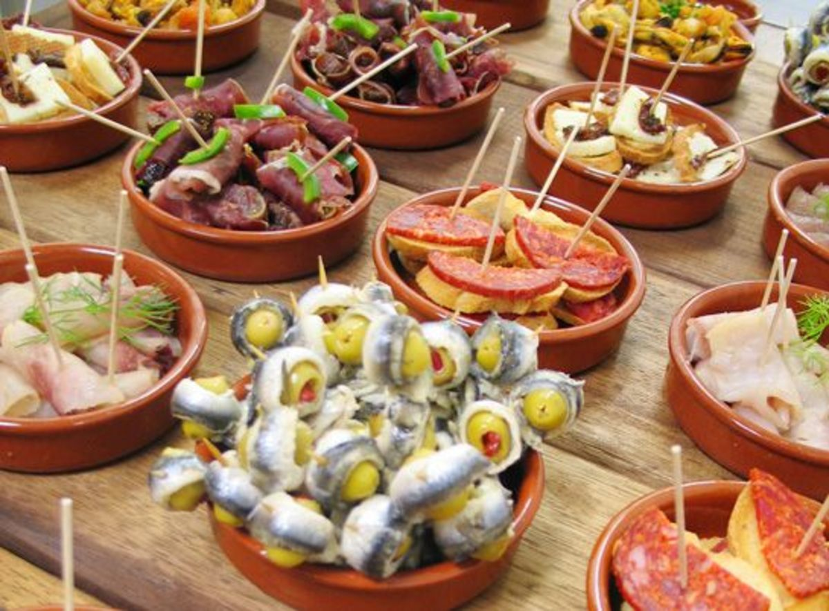 Pintxos are similar to tapas, but they are almost always held together with skewers.
