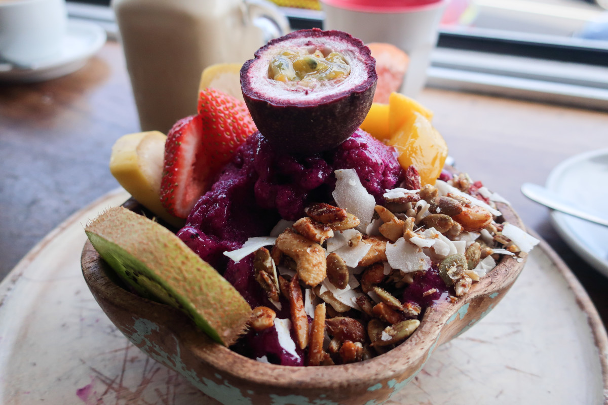 A vegan salad loaded with fruits and nuts.