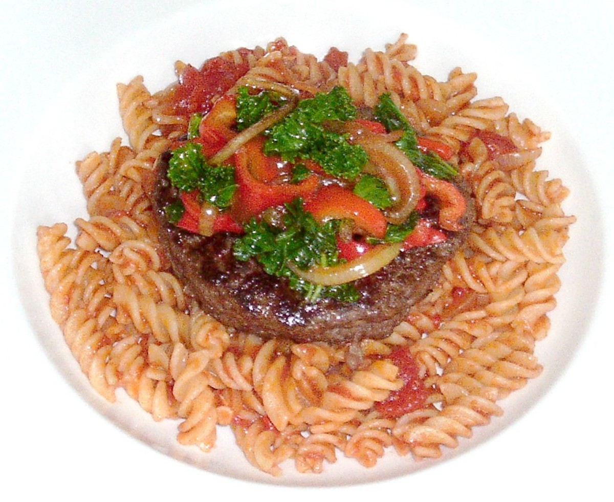 Sauteed kale and bell peppers served with an ostrich burger and fusilli pasta is one of the recipes featured on this page