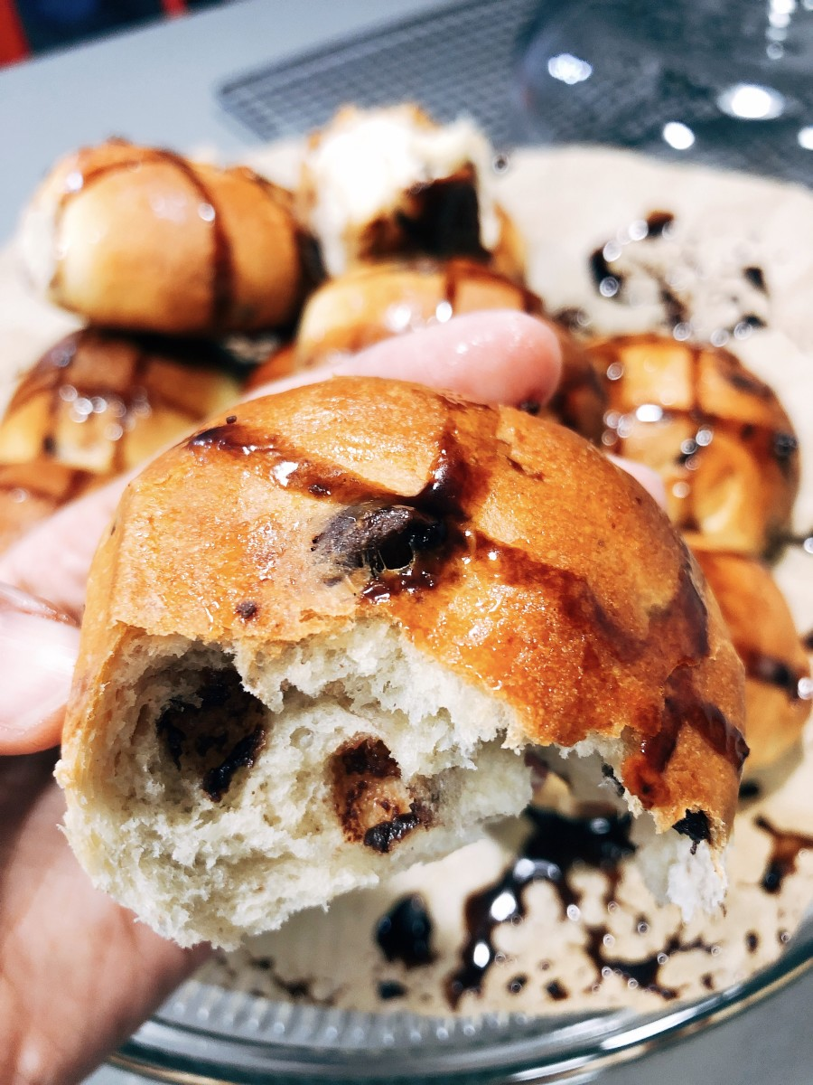 Warm and delicious homemade chocolate hot cross buns.