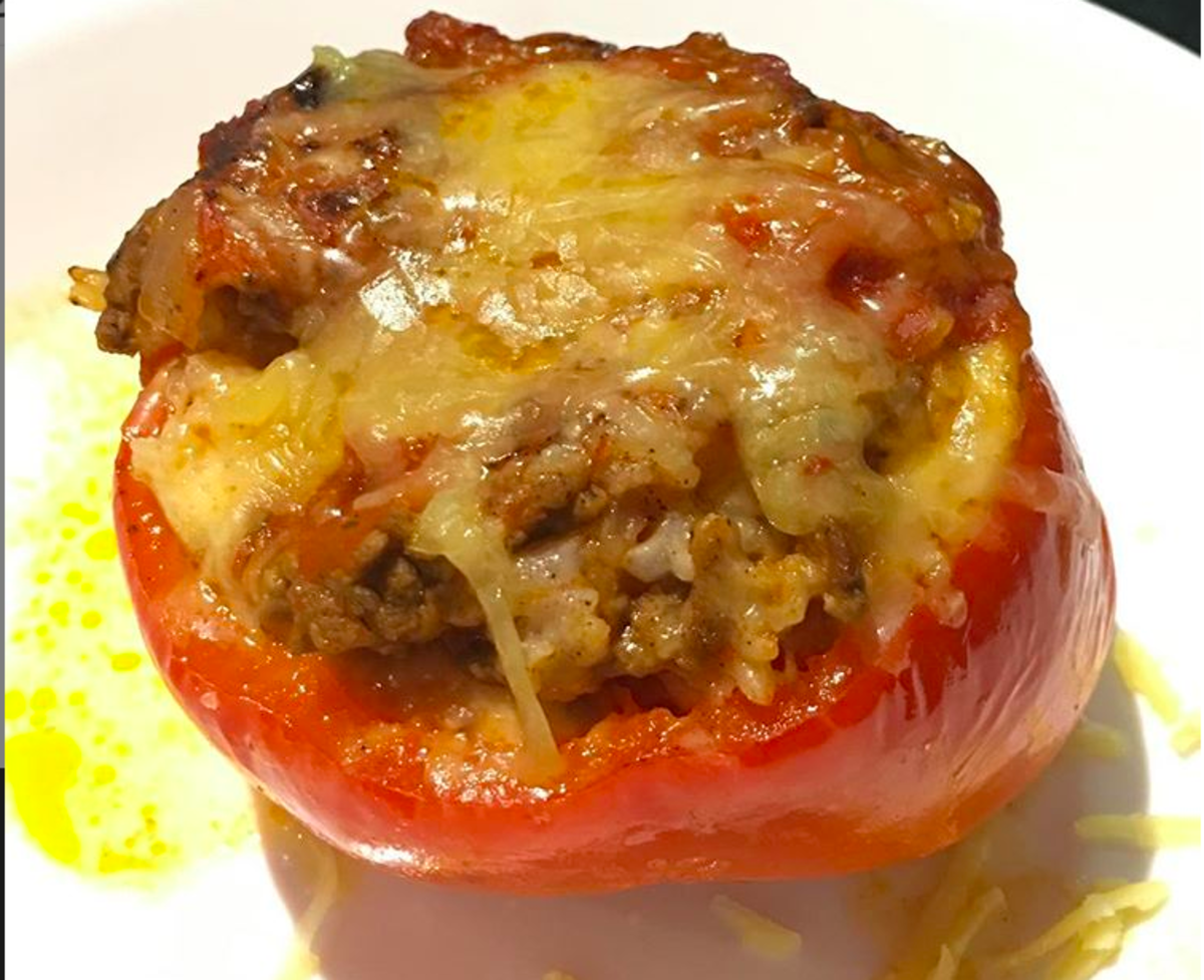 Slow-cooked beef, rice, and tomato stuffed capsicums (bell pepper)