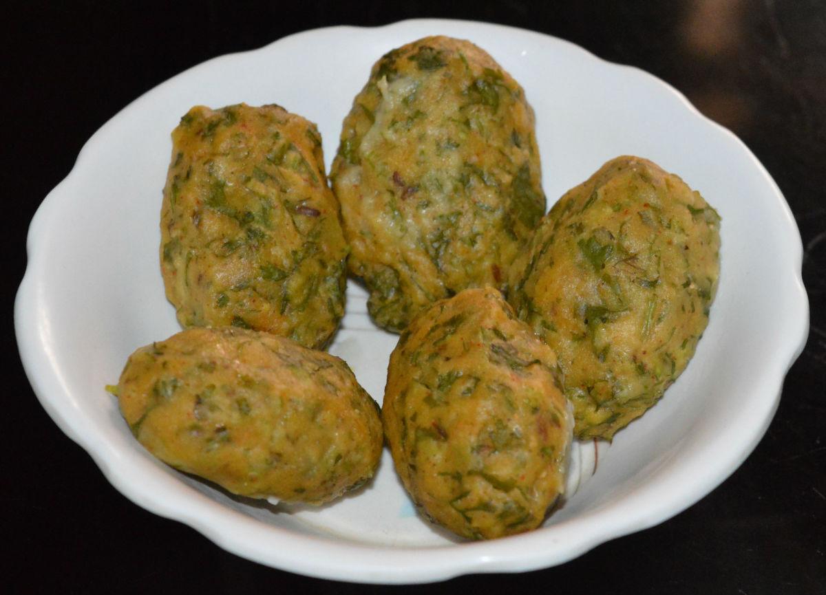 Kothimbir vadi (steamed coriander chickpea flour balls).